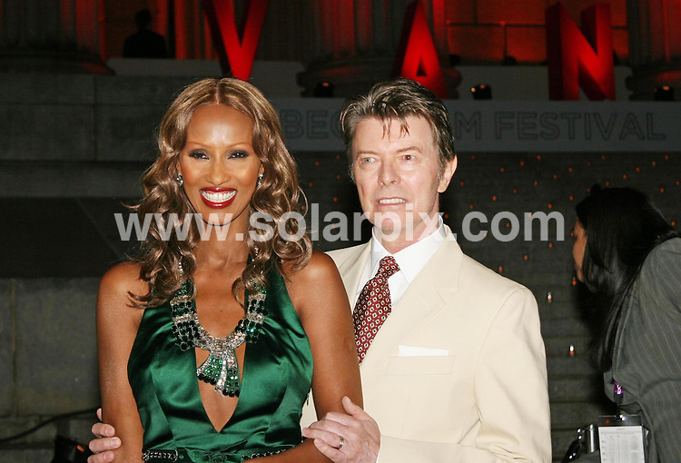 **ALL ROUND PICTURES FROM SOLARPIX.COM**.**SYNDICATION RIGHTS FOR UK, SPAIN, PORTUGAL, AUSTRALIA, S.AFRICA & DUBAI (U.A.E) ONLY**.The  6th Annual Tribeca Film Festival Vanity Fair Party at The State Supreme Court House in New York, NY USA.This Pic:David Bowie & Iman.JOB REF: 3768    PHZ    DATE: 25.04.07.**MUST CREDIT SOLARPIX.COM OR DOUBLE FEE WILL BE CHARGED* *UNDER NO CIRCUMSTANCES IS THIS IMAGE TO BE REPRODUCED FOR ANY ONLINE EDITION WITHOUT PRIOR PERMISSION*