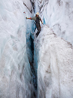 """CREVASSE PLAY"" -- A climber has some fun in crevasses near camp."