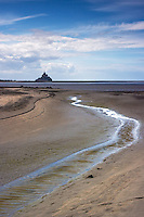 Low tide at the bay of Mont Saint Michel in Normandy, France, on a beautiful summer morning.