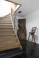 The design of the staircase in the entrance hall is based on the traditional farmhouse style with the base tread made from stone