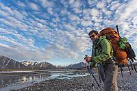 Crossing the Ribdon river. Arctic National Wildlife Refuge, Brooks Range, Arctic Alaska.