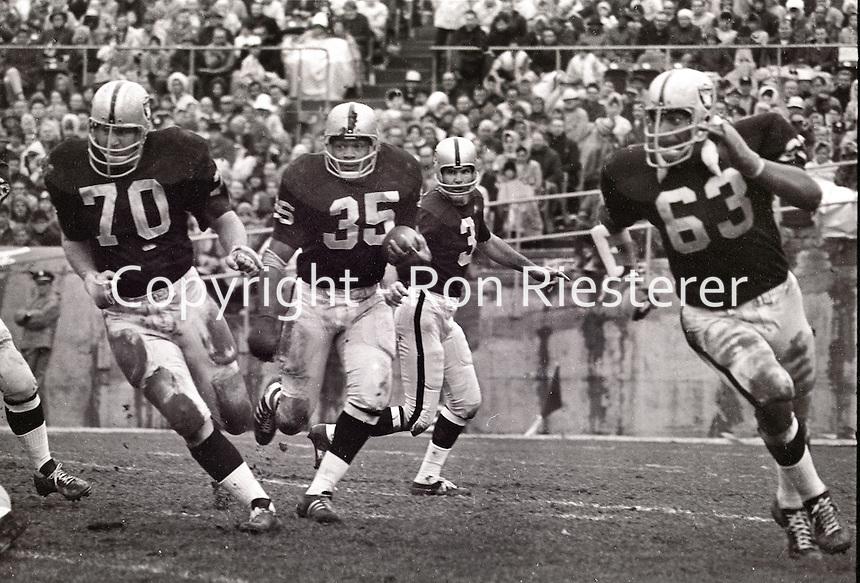 Oakland Raiders rush..#70 Jim Harvey leading Hewritt Dixon, Daryle Lamonica, and Gene Upshaw...(photo/Ron Riesterer)