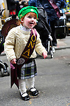 March 16, 2013 - New York, NY, U.S. - Little GRACE TAYLOR, 20 months old, is getting ready to march with the Iona College, New Rochelle, NY, group at the 252nd annual NYC St. Patrick's Day Parade. Thousands of marchers show their Irish pride, as they march up Fifth Avenue, and over a million people, often in green and orange, watch and celebrate.