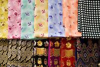 United Arab Emirates, Dubai, Colorful fabrics for sale in the Souq