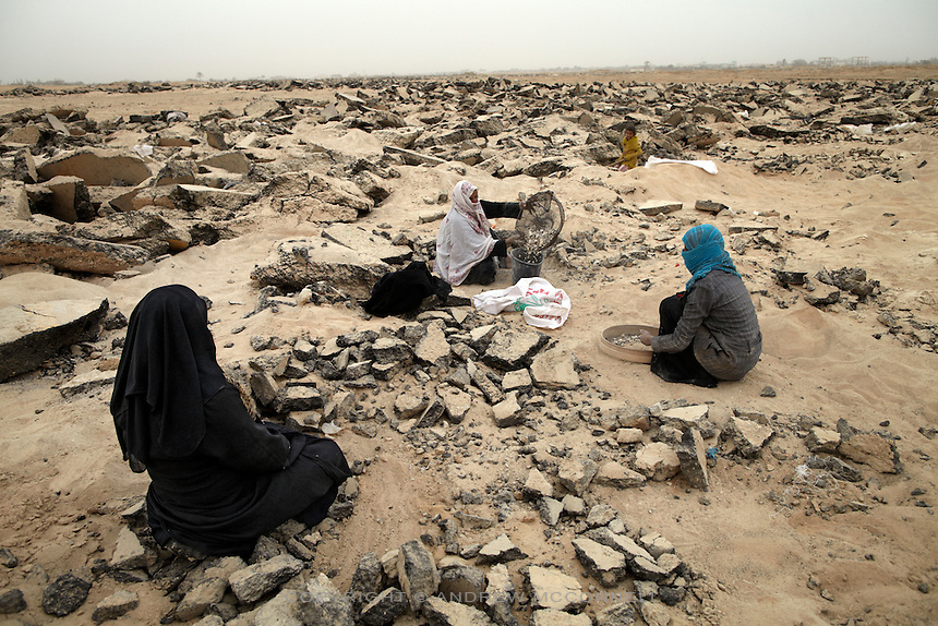 Women gather gravel from the destroyed runway at Yasser Arafat International Airport, in Gaza. Under the blockade gravel is needed for use in construction, especially the production of concrete.