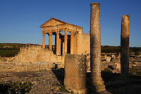 General view of the Roman Capitol with columns in the foreground, 2nd century, in Dougga, Tunisia, pictured on January 31, 2008, in the morning. Dougga has been occupied since the 2nd Millennium BC, well before the Phoenicians arrived in Tunisia. It was ruled by Carthage from the 4th century BC, then by Numidians, who called it Thugga and finally taken over by the Romans in the 2nd century. Situated in the north of Tunisia, the site became a UNESCO World Heritage Site in 1997. This is one of the best preserved Roman temples in North Africa with a portico of six Corinthian columns. Picture by Manuel Cohen.