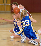 NAUGATUCK, CT- 02 JAN 06- 010207JT07- <br /> Naugatuck's Julie Piroscafo tries to keep control of the ball while Seymour's Nicole Dow and Caitlin Eastwood (33) scramble during Tuesday's game at Naugatuck. Seymour won 41-44.<br /> Josalee Thrift Republican-American