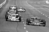 "HAMPTON, GA - APRIL 22: Tom Bagley (#11 Penske PC6/Cosworth TC) and David ""Salt"" Walther (#77 Penske PC6/Cosworth TC) drive on the front straight during the Gould Twin Dixie 125 event on April 22, 1979, at Atlanta International Raceway near Hampton, Georgia."