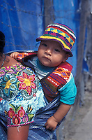 Mayan baby on his mother's back in the Spanish colonial town of Antigua, Guatemala