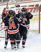 ?, Casey Pickett (NU - 14) and Julia Marty (NU - 16) celebrate MacSorley's goal. - The Northeastern University Huskies tied Boston University Terriers 3-3 in the 2011 Beanpot consolation game on Tuesday, February 15, 2011, at Conte Forum in Chestnut Hill, Massachusetts.