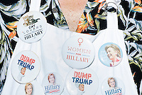 Jack Lieberman, of Hollywood, Florida, sells pro-Clinton campaign buttons to people waiting to enter a campaign rally for Democratic presidential nominee Hillary Clinton in the Theodore R. Gibson Health Center at Miami Dade College-Kendall Campus in Miami, Florida, USA. Former Vice President Al Gore also spoke at the rally. Lieberman runs the campaign and politics apparel website ProgressiveRags.com.