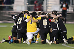 11 December 2009: Wake Forest starters huddle before the game. The University of Virginia Cavaliers defeated the Wake Forest University Demon Deacons 2-1 after overtime at WakeMed Soccer Stadium in Cary, North Carolina in an NCAA Division I Men's College Cup Semifinal game.