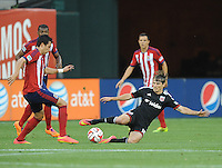 Washington D.C. - July 21, 2014:  Chris Rolfe (18) of D.C. United  goes against Erick Torres of Chivas USA. D.C. United defeated the Chivas USA 3-1 during a Major League Soccer match for the 2014 season at RFK Stadium.