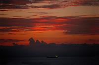 A cargo ship off of South Beach, Miami, Florida at sunrise..