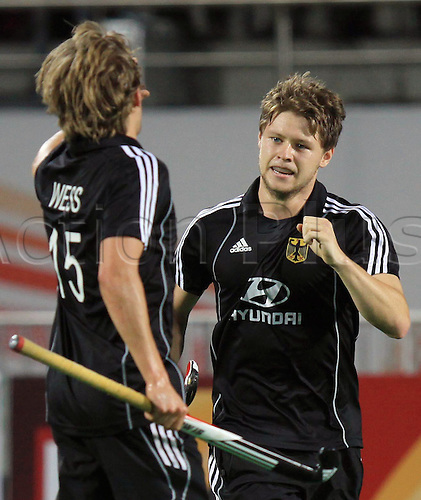11.03.2010. Delhi,India. FIH World Cup Field Hockey. Germany's Martin Haner celebrate with teammates after scoring goal against England at the World Cup 2010 match at the Major Dhyan Chand Stadium in New Delhi Photo: Pankaj Nangia/Actionplus - Editorial Use