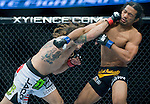 Clay Guida connects with a right to the face of Benson Henderson in a lightweight match during Saturday's UFC on Fox event at the Honda Center.