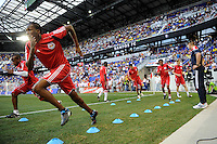 Dane Richards (19) (L) and Macoumba Kandji (10) (R) warm up prior to a friendly between Santos FC and the New York Red Bulls at Red Bull Arena in Harrison, NJ, on March 20, 2010. The Red Bulls defeated Santos FC 3-1.