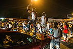 BATON ROUGE, LA -JULY 06:  Protesters block traffic and dance on the hood of a car near theTriple S Food Mart where Alton Sterling was shot and killed by police on July 5, 2016 in Baton Rouge, Louisiana. (Photo by Mark Wallheiser/Getty Images)