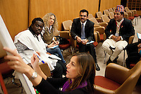 Switzerland. Geneva. World Health Organisation (WHO). Stop TB Partnership. Brainstorming activity on the role of a goodwill ambassador. Workshop with a group of national ambassadors against tuberculosis: (left to right by numbers) Obour (1), Ghana, Pop singer. Sonia Goldemberg (2), Peru, Journalist. Deepak Raj Giri (4), Nepal, TV movie actor. Other people attend also the workshop: Wasiq Khan (3), WHO Regional office for the Eastern Mediterranean and Aziyade Poltier (6) , United Nations Development Programme (UNDP) who is writing on the board while standing on her knees. 5.12.2011 © WHO /Didier Ruef