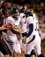 Jacob Wark of California congrats California kicker Vincenzo D'Amato after D'Amato scored PAT during the game against Utah at Rice-Eccles Stadium in Salt Lake City, Utah on October 27th, 2012.   Utah Utes defeated California, 49-27.