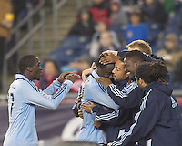 Sporting Kansas City midfielder Kei Kamara (23) celebrates his goal with teammates. In a Major League Soccer (MLS) match, the New England Revolution defeated Sporting Kansas City, 3-2, at Gillette Stadium on April 23, 2011.