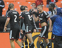 Washington D.C. - March 29, 2014:  Perry Kitchen (23) of D.C. United celebrates his score with teammates. The Chicago Fire tied D.C. United 2-2 during a Major League Soccer match for the 2014 season at RFK Stadium.