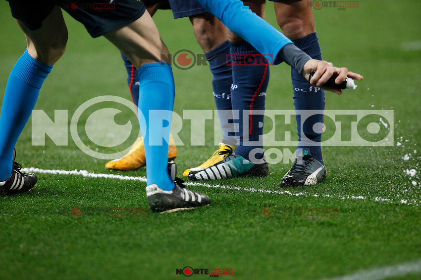 Referee Wolfgang Stark marks with the spray during Champions League soccer match between Atletico de Madrid and Olympiacos at Vicente Calderon stadium in Madrid, Spain. November 26, 2014. (ALTERPHOTOS/Victor Blanco) /NortePhoto
