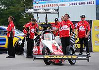 Jun 6, 2016; Epping , NH, USA; NHRA top fuel driver Doug Kalitta with crew members during the New England Nationals at New England Dragway. Mandatory Credit: Mark J. Rebilas-USA TODAY Sports