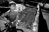 Wroclaw 22.05.2006 Poland<br /> The worst and the most dangerous district in Wroclaw ( Poland ) , called by people &quot;The Bermuda Triangle&quot;. There are walls bearing an inscription &quot;Who will enter here, will not exit alive&quot; Many families there are pathological and live in extreme poverty. Children have no place for any games so they loaf around on this wasted district and disseminate a juvenile delinquency. Many of them become sexually active though they are only 10-12 years old<br /> (Photo by Adam Lach / Napo Images)<br /> <br /> Najbardziej nabezpieczna dzielnica we Wroclawiu zwana przez ludzi Trojkatem Bermudzkim. Sa tam sciany opatrzone napisem &quot; Kto tu wejdzie, nigdy nie wyjdzie stad zywy&quot; Mieszka tam wiele rodzin patologicznych i zyja w wielkiej nedzy. Dzieci wlocza sie po ulicach nie majac miejsc na zabawe i szerza przestepczosc wsrod nieletnich. Wiele z dzieci uprawia seks choc maja zaledwie 10-12 lat<br /> (Fot Adam Lach / Napo Images)