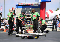 Sept. 15, 2012; Concord, NC, USA: Crew members work on the car of NHRA top fuel dragster driver Terry McMillen during qualifying for the O'Reilly Auto Parts Nationals at zMax Dragway. Mandatory Credit: Mark J. Rebilas-