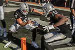 Oakland Raiders quarterback Derek Carr (4) and wide receiver Michael Crabtree (15) celebrates touchdown on Sunday, October 9, 2016, at O.co Coliseum in Oakland, California.  The Raiders defeated the Chargers 34-31.