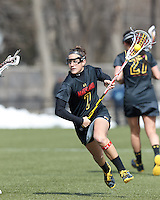 University of Maryland midfielder Katie Schwarzmann (7) on the attack. .University of Maryland (black) defeated Boston College (white), 13-5, on the Newton Campus Lacrosse Field at Boston College, on March 16, 2013.