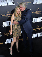 Gary Busey &amp; Steffanie Sampson at the premiere of &quot;John Wick Chapter Two&quot; at the Arclight Theatre, Hollywood. <br /> Los Angeles, USA 30th January  2017<br /> Picture: Paul Smith/Featureflash/SilverHub 0208 004 5359 sales@silverhubmedia.com