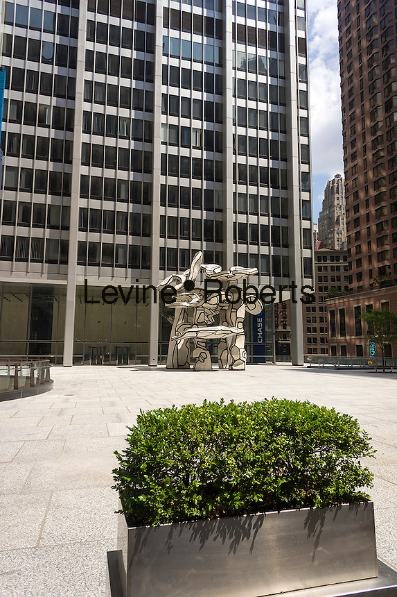 "One Chase Manhattan Plaza with its famous ""Group of Four Trees"" sculpture by Jean Dubuffet on Rockefeller Plaza is seen in Lower Manhattan in New York on Saturday, August 17, 2013. The landmark building and plaza, owned by JPMorgan Chase, has recently been offered for sale with an estimate of worth of $1 billion. The 60 story building was designed by Skidmore, Owings & Merrill and was completed in 1961. (© Richard B. Levine)"