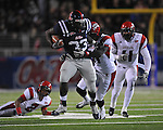 Ole Miss fullback E.J. Epperson (33) is chased by Louisiana-Lafayette's Devon Lewis-Buchanan (11) and Louisiana-Lafayette's Colin Windsor (51)  vs. Louisiana-Lafayette in Oxford, Miss. on Saturday, November 6, 2010. Ole Miss won 43-21.