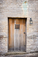 An outside door to the manor house has been left in its natural, unpainted state to complement the mellow stone of the walls