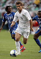 Kyle Beckerman (5) dribbles away from two Honduran players.  The US Men's National Team defeated Honduras 2-0 in the semifinals of the Gold Cup at Soldier Field in Chicago, IL on July 23, 2009.