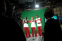 INDIANAPOLIS, IN - APRIL 1, 2011: Chiney Ogwumike, Jeanette Pohlen and Nnemkadi Ogwumike prepare for an on camera taping at Conseco Fieldhouse during the NCAA Final Four in Indianapolis, IN on April 1, 2011.