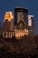 Minneapolis skyline with the Basilica of St. Mary in the foreground.
