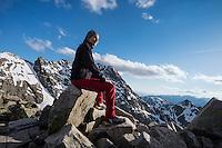 Female hiker on the summit of Koscielec (2155m), Tatra mountains, Poland