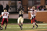 4 November 2006: Boston College quarterback Matt Ryan (12) throws a pass just over the outstretched hands of Wake Forest's Anthony Davis (93) for a completion. Wake Forest defeated Boston College 21-14 at Groves Stadium in Winston-Salem, North Carolina in an Atlantic Coast Conference college football game.