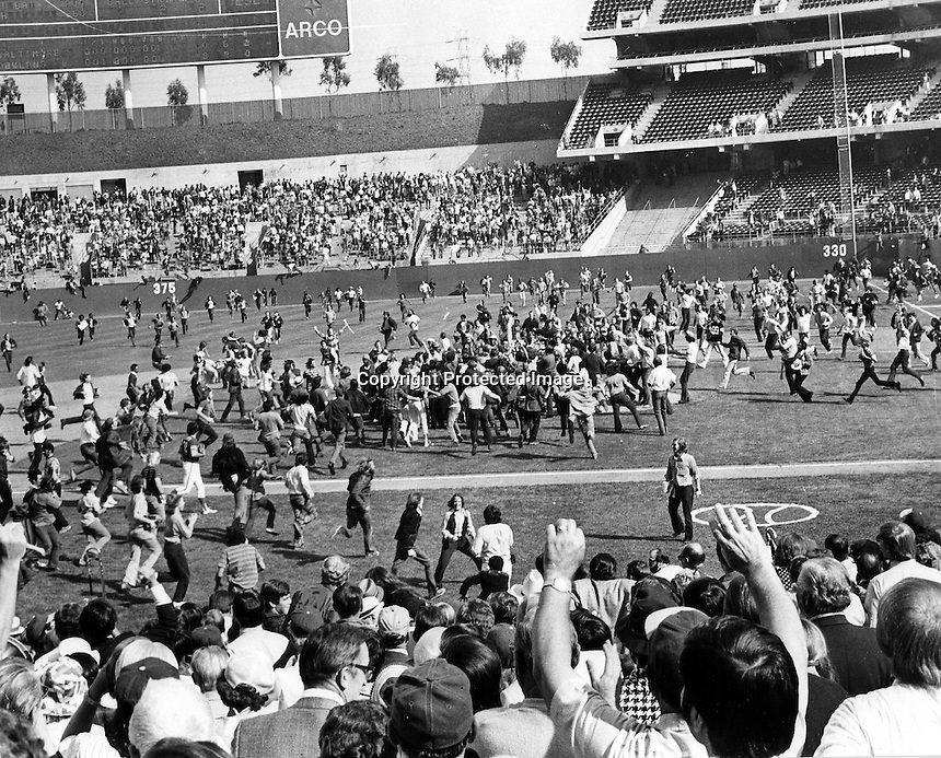 "Oakland Alameda County Coliseum...fans swarm the field after the Oakland Athletics just defeated the Baltimore Orioles to win the 1973 American League Pennant. Jim ""Catfish"" hunter hurled a 6 hit shutout for the win. (1973 copyright/Ron Riesterer)"