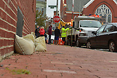 October 28, 2012 (Washington, DC)   Homeowners sandbagged a low window in Bloomingdale as D.C. Department of Public Works (DPW) employees distribute sandbags to residents in preparation for Hurricane Sandy  (Photo by Don Baxter/Media Images International)