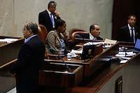 Arab-Israeli parliament Achmad Tibi turns his back to the parliament on the speaker stand, as the Israeli parliament votes on the so-called governability law. July 31, 2013. Photo by Oren Nahshon
