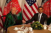 With the news that Afghan peace council leader, former President Burhanuddin Rabbani of Afghanistan, was killed by a suicide bomber casting a cloud over their talks, Afghan President Hamid Karzai, left, shakes hands with United States President Barack Obama, right, during the U.N. General Assembly in New York, New York on Tuesday, September 20, 2011..Credit: Allan Tannenbaum / Pool via CNP