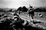 barwaiz raghzai hills, south waziristan, april 2004: a group of men from the ahmedzai tribal lashkar begin their mountain search for al qaeda hideouts.  the pakistan government accused the ahmedzai of harboring al qaeda fighters in these mountains.<br />