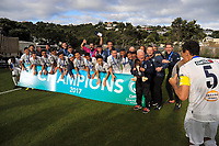 Auckland captain Angel Berlanga (right) kisses the trophy as his team looks on after winning the Oceania Football Championship final (second leg) football match between Team Wellington and Auckland City FC at David Farrington Park in Wellington, New Zealand on Sunday, 7 May 2017. Photo: Dave Lintott / lintottphoto.co.nz