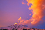 Evening light on clouds over Mount Rainier, Mount Rainier National Park, Washington USA