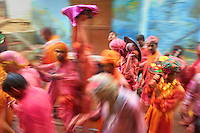 People playing holi in the streets of a village near Mathura, India.