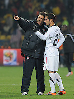 U.S. assistant coach Mike Sorber instructs midfielder Bennie Feilhaber prior to his going on as a substitute to begin the second half. Ghana defeated the U.S., 2-1, in extra time to advance to the quarterfinals, Saturday, June 26th, at the 2010 FIFA World Cup in South Africa..